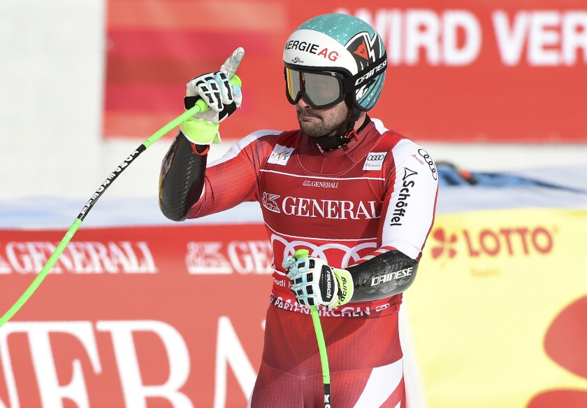 Austria's Vincent Kriechmayr celebrates as he arrives at the finish area during an alpine ski, men's World Cup super-G race in Garmisch-Partenkirchen, Germany, Saturday, Feb. 6, 2021. (AP Photo/Marco Tacca)