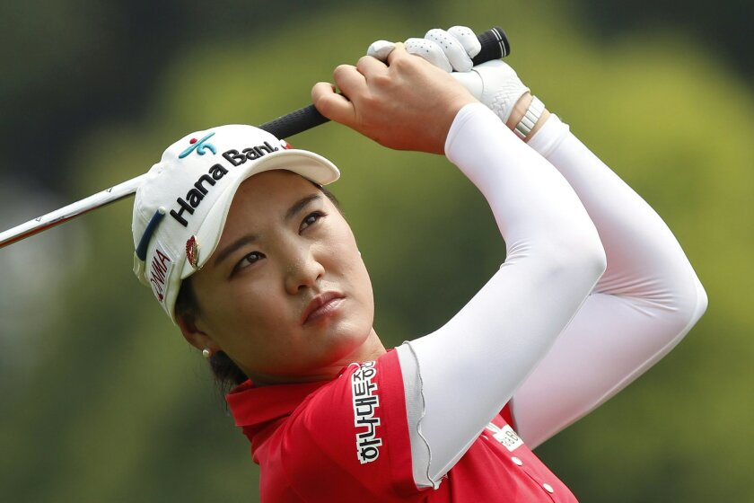 So Yeon Ryu of South Korea watches her shot on the 18th hole during the second round of the LPGA Malaysia golf tournament at Kuala Lumpur Golf and Country Club in Kuala Lumpur, Malaysia, Friday, Oct. 10, 2014. (AP Photo/Lai Seng Sin)