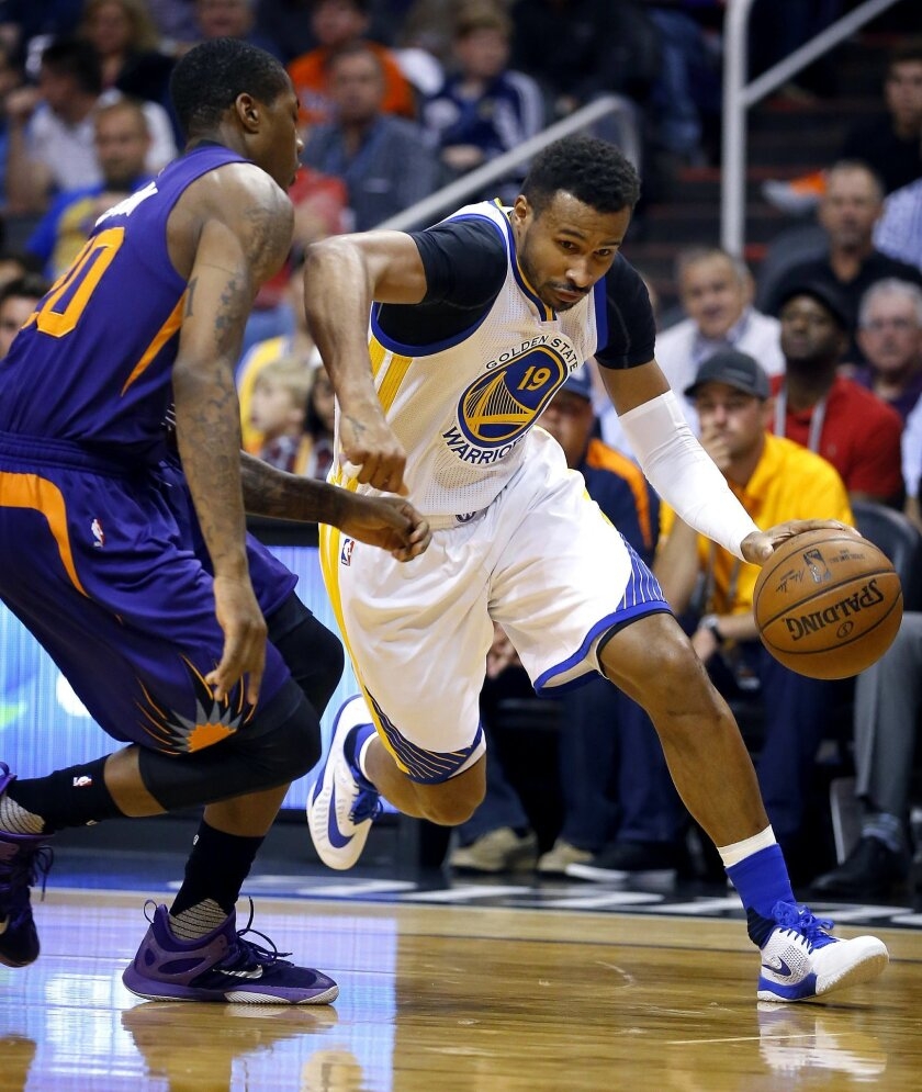 Golden State Warriors' Leandro Barbosa, of Brazil, drives past Phoenix Suns' Sonny Weems, left, during the first half of an NBA basketball game Wednesday, Feb. 10, 2016, in Phoenix. (AP Photo/Matt York)