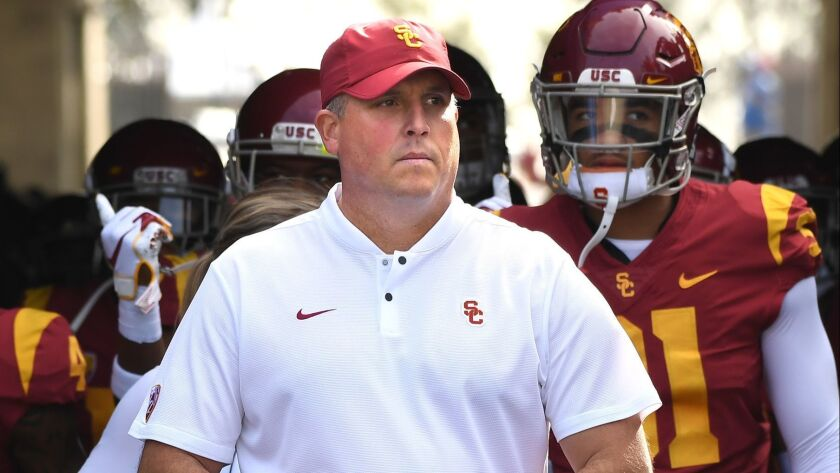USC head coach Clay Helton leads his team to the field before a game against UCLA at the Rose Bowl on Saturday.