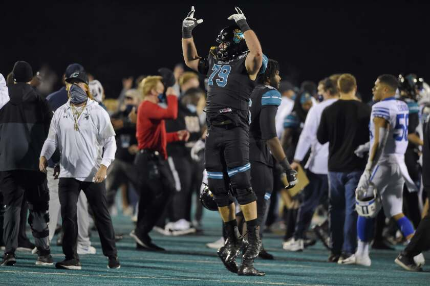 Coastal Carolina's Steven Bedosky celebrates after Saturday's 22-17 victory over Brigham Young.