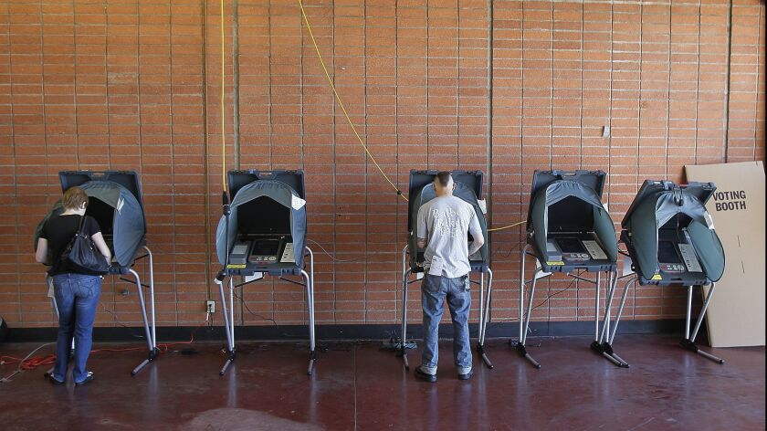Residents of Newport Beach cast their ballots during election day at the Balboa Peninsula Fire Stati