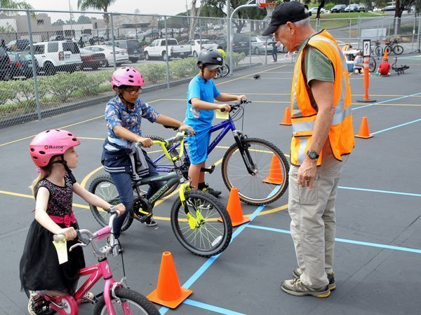 Lucy, Melissa, and Tyler practice their bike skills with Dave White