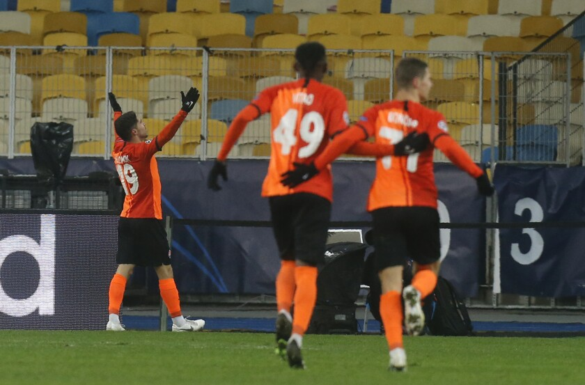 Shakhtar's Manor Solomon celebrates after scoring his side's second goal during the Champions League, Group B, soccer match between Shakhtar Donetsk and Real Madrid at the Olimpiyskiy Stadium in Kyiv, Ukraine, Tuesday, Dec. 1, 2020. (AP Photo/Efrem Lukatsky)