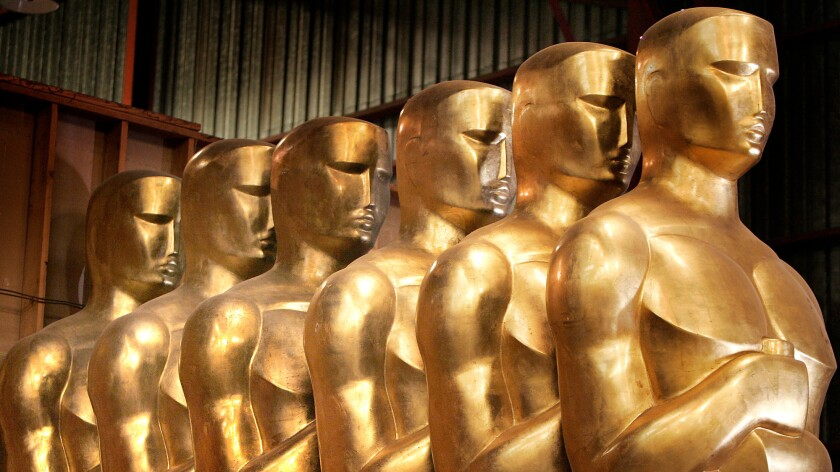 Oversized Oscar statues line the Dolby Theatre in Hollywood for the Academy Awards.