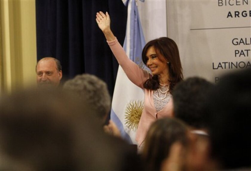 Argentina's President Cristina Fernandez waves to supporters and members of the gay community after signing the same sex marriage bill at the Latin America Patriots room of the government house in Buenos Aires, Wednesday, July 21, 2010. (AP Photo/Eduardo Di Baia)