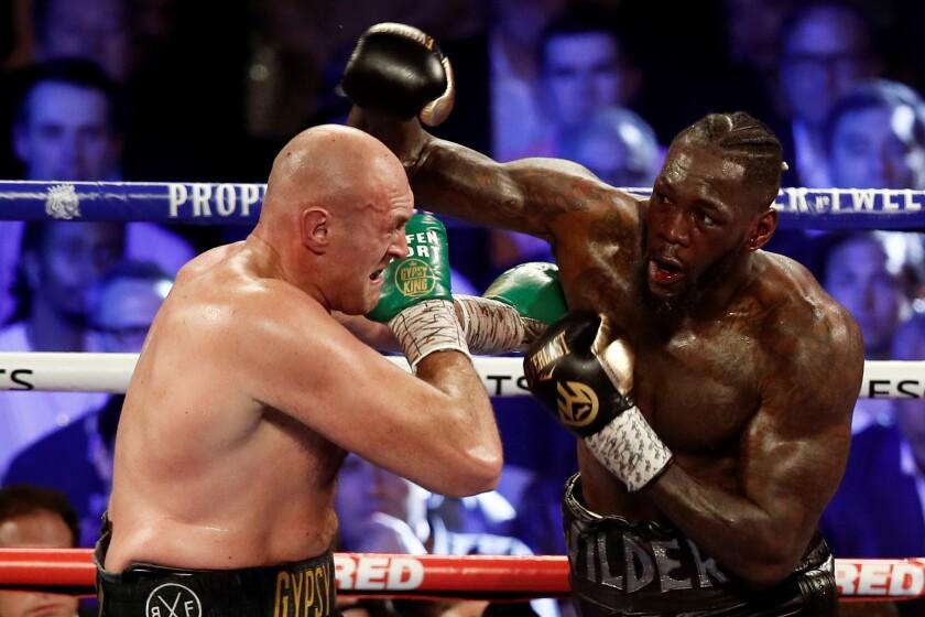 Tyson Fury (izquierda) y Deontay Wilder en su enfrentamiento de febrero de 2020.