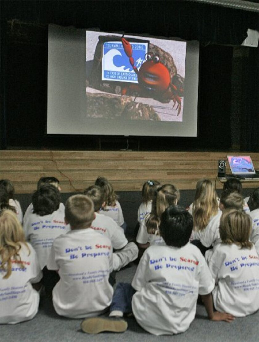 Students at Del Mar Heights Elementary  School watched an animated DVD about  tsunami preparedness yesterday. (Eduardo Contreras / Union-Tribune)