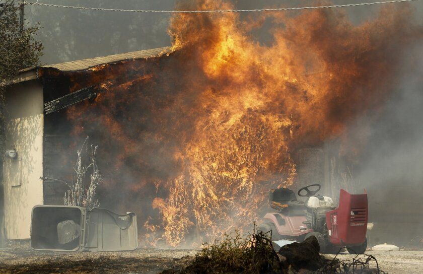 From May of 2014, a garage of a home burns on Mount Whitney Road just west of Escondido.