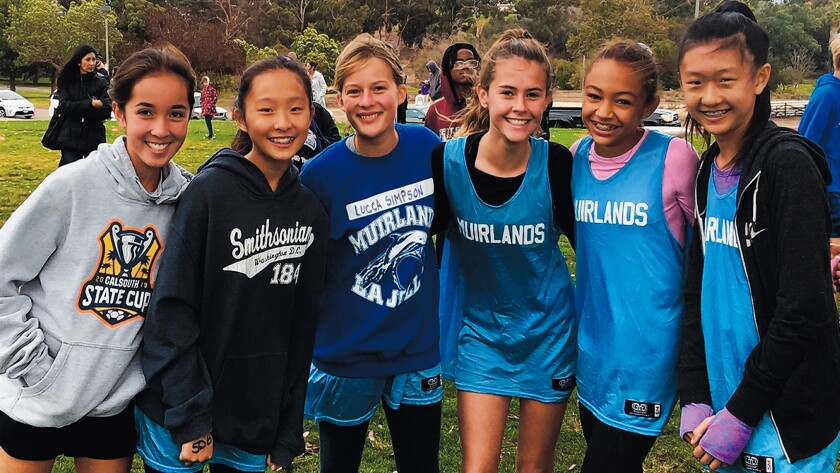 Students from Muirlands Middle School in La Jolla get ready for San Diego Unified School District's middle school cross-country meet Nov. 20, 2019 at Morley Field Sports Complex in Balboa Park, San Diego. Pictured: Sienna Gustafson, Natalie Pong, Elena Tyvoll, Stella Hurley, Payton Smith and Shannon Cao.