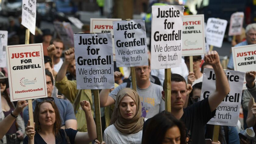 LONDON, ENGLAND - JUNE 16: Protesters attend a rally calling for justice for those affected by the