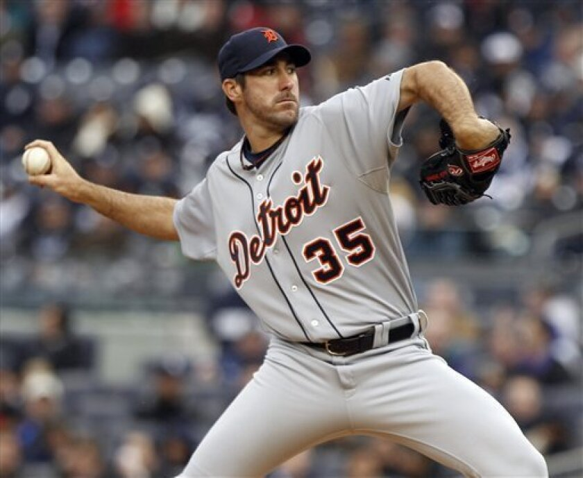 Detroit Tigers starting pitcher Justin Verlander (35) delivers a pitch during the second inning of a baseball game against the New York Yankees on opening day Thursday, March 31, 2011, at Yankee Stadium in New York. (AP Photo/Frank Franklin II)