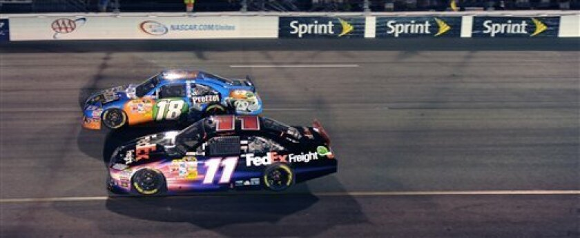 Denny Hamlin (11) and Kyle Bush (18) are side by side in turn two during the NASCAR Sprint Cup auto race at Richmond International Raceway in Richmond, Va., Saturday April 30, 2011. (AP Photo/Clem Britt)