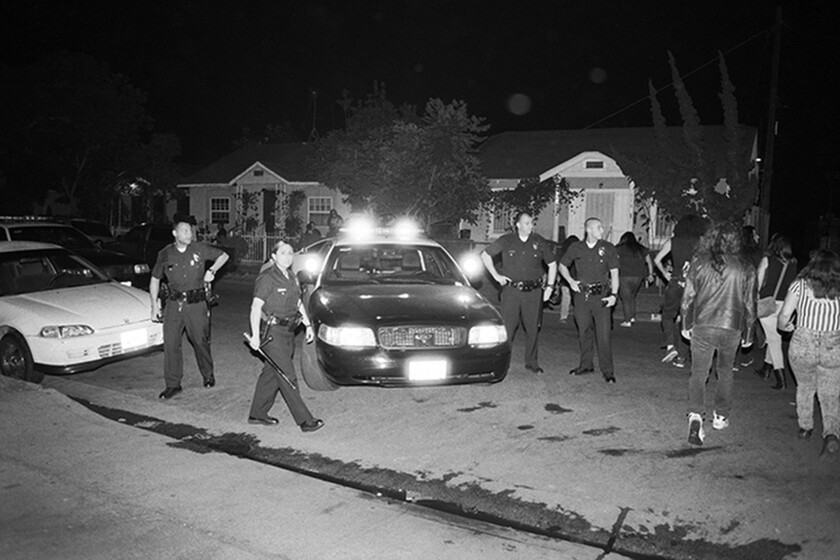 """LAPD officers raid a show in South-Central Los Angeles in a scene from """"Los Punks: We Are All We Have."""""""