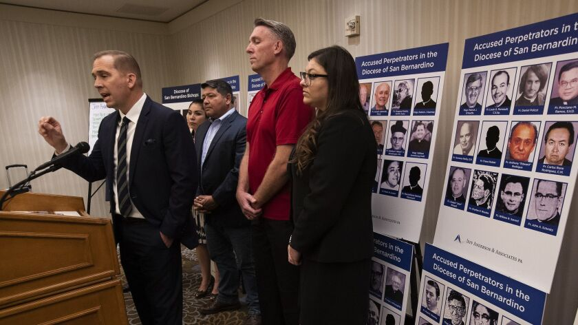 ONTARIO, CA-JANUARY 31, 2019: Attorney Mike Reck, left, talks to the media during a press conferenc