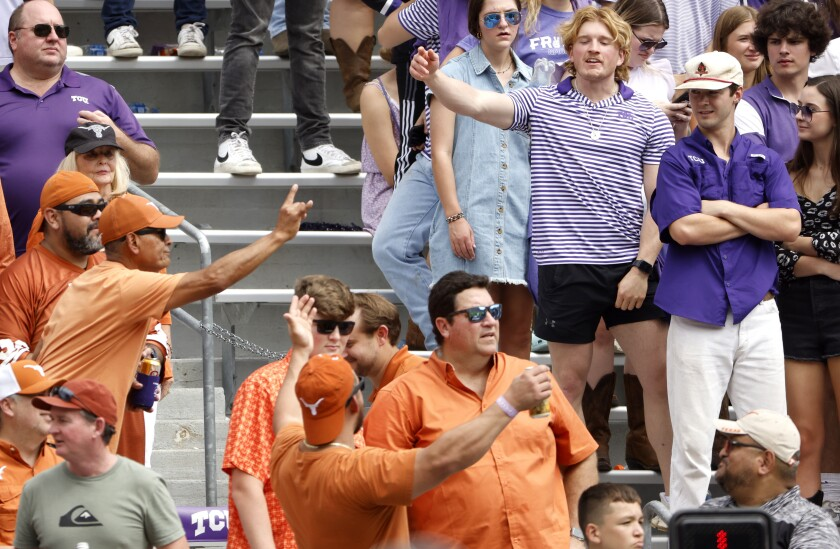 Texas and TCU fans let their feelings show during the second half of an NCAA college football game Saturday, Oct. 2, 2021, in Fort Worth, Texas. Texas won 32-27. (AP Photo/Ron Jenkins)
