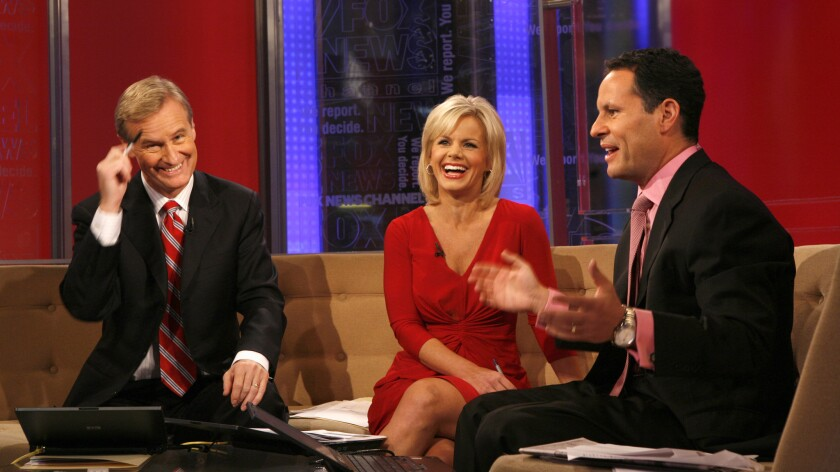 """Hosts Steve Doocy, left, Gretchen Carlson and Brian Kilmeade on """"Fox & Friends"""" in October 2008. Carlson alleges she was pulled off the show after complaining about her treatment by Doocy."""