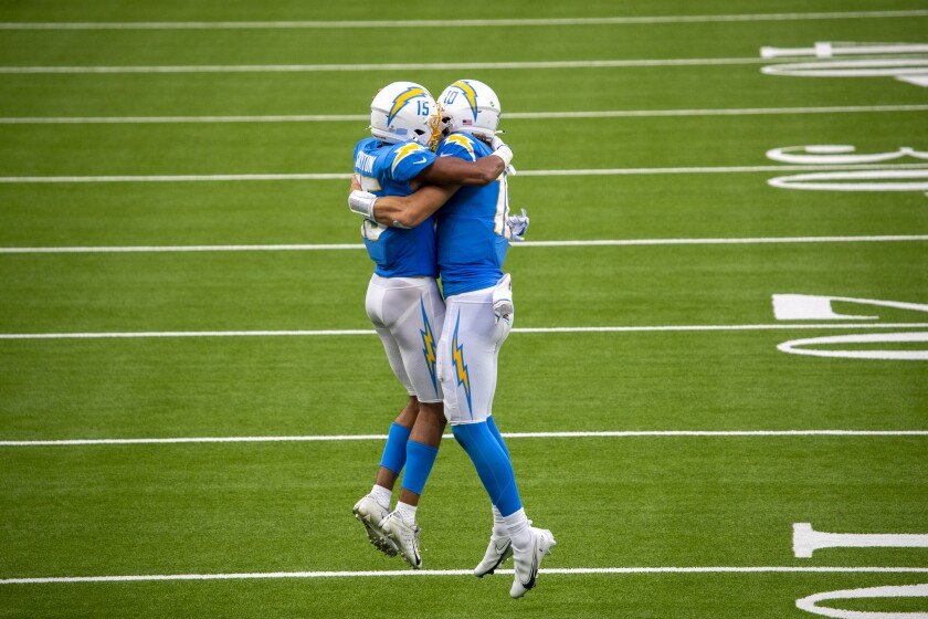 Chargers quarterback Justin Herbert, right, celebrates with wide receiver Jalen Guyton.