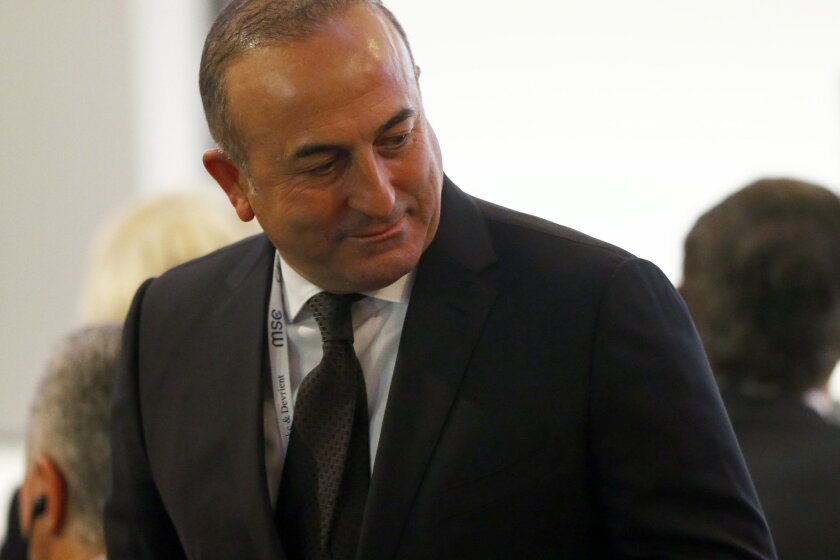 Turkish Foreign Minister Mevlut Cavusoglu  arrives at the Munich Security Conference in Munich, Germany, Friday, Feb. 12, 2016. (AP Photo/Matthias Schrader)