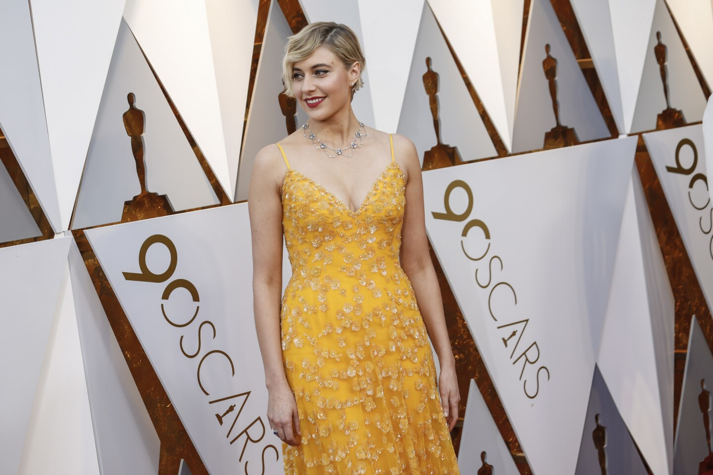 """Lady Bird"" director Greta Gerwig arrives at the 90th Academy Awards."