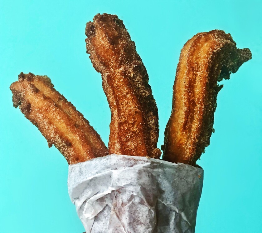 A three-churro order from The Taco Stand, a local chain that aims to re-create the food found at Tijuana's taquerias.