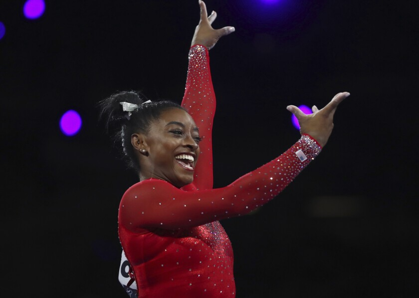 Simone Biles reacts after completing her vault during her gold-medal winning effort Saturday at the gymnastics world championships.