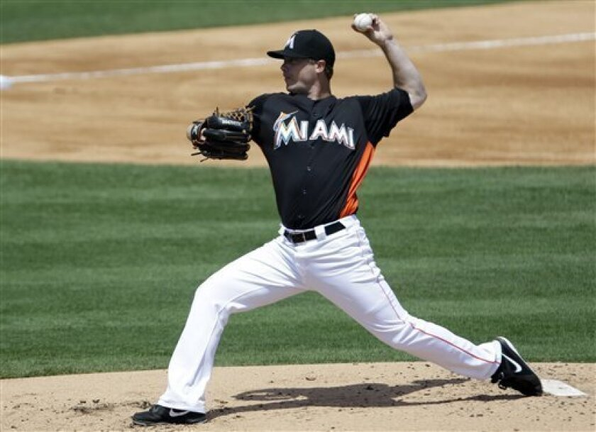 Miami Marlins starting pitcher Wade LeBlanc throws during the second inning of an exhibition spring training baseball game against the Detroit Tigers Monday, March 25, 2013, in Jupiter, Fla. (AP Photo/Jeff Roberson)