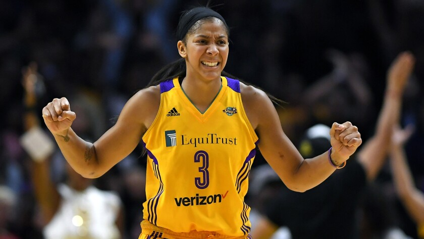 Candace Parker celebrates during the Sparks' Game 3 victory in the WNBA Finals against the Minnesota Lynx, which moved them to within one win of back-to-back titles.