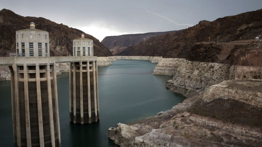 FILE - In this July 28, 2014 file photo, lightning strikes over Lake Mead near Hoover Dam at the Lak
