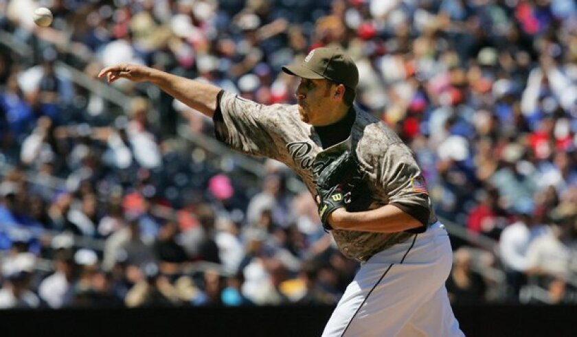 Padres starter Aaron Harang grabbed the win after San Diego beat L.A. 7-2 on Sunday.