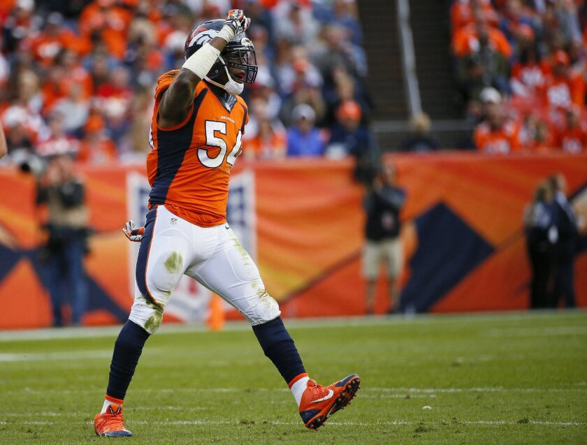 FILE - In this Nov. 15, 2015, file photo, Denver Broncos inside linebacker Brandon Marshall celebrates a stop during the Broncos' NFL football game against the Kansas City Chiefs in Denver. Marshall had screws removed from his right foot on Friday, Feb. 19, 2016, but said doctors decided to leave i