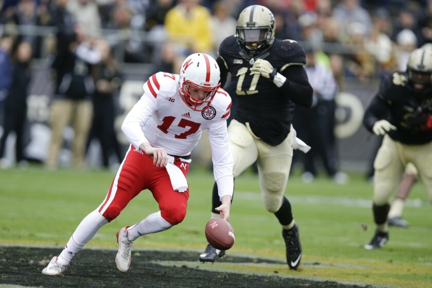 Nebraska quarterback Ryker Fyfe (17) tries to recover a fumble in front of Purdue defensive end Antoine Miles (11) during the first half of an NCAA college football game in West Lafayette, Ind., Saturday, Oct. 31, 2015. Purdue recovered the ball.  (AP Photo/Michael Conroy)