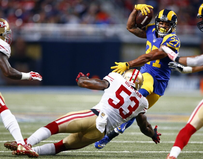 St. Louis Rams running back Tre Mason (27) runs with the ball as San Francisco 49ers inside linebacker NaVorro Bowman defends during the third quarter of an NFL football game, Sunday, Nov. 1, 2015, in St. Louis. (AP Photo/Billy Hurst)