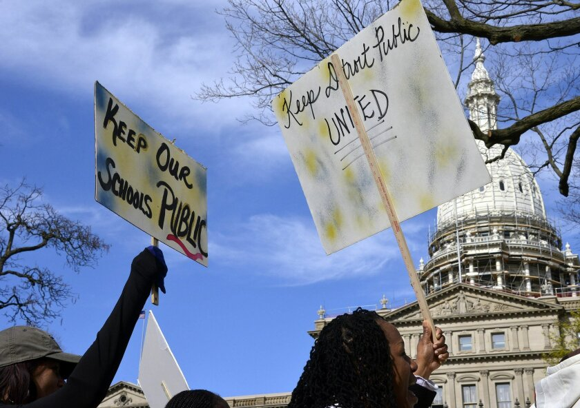 """Detroit Public School teachers demonstrate in front of the Capitol Thursday morning, April 30, 2015, in Lansing, Mich. Steve Conn, head of the Detroit Federation of Teachers, said Gov Rick Snyder's proposed overhaul of the district announced Thursday is causing the union to """"draw a line in the sand"""
