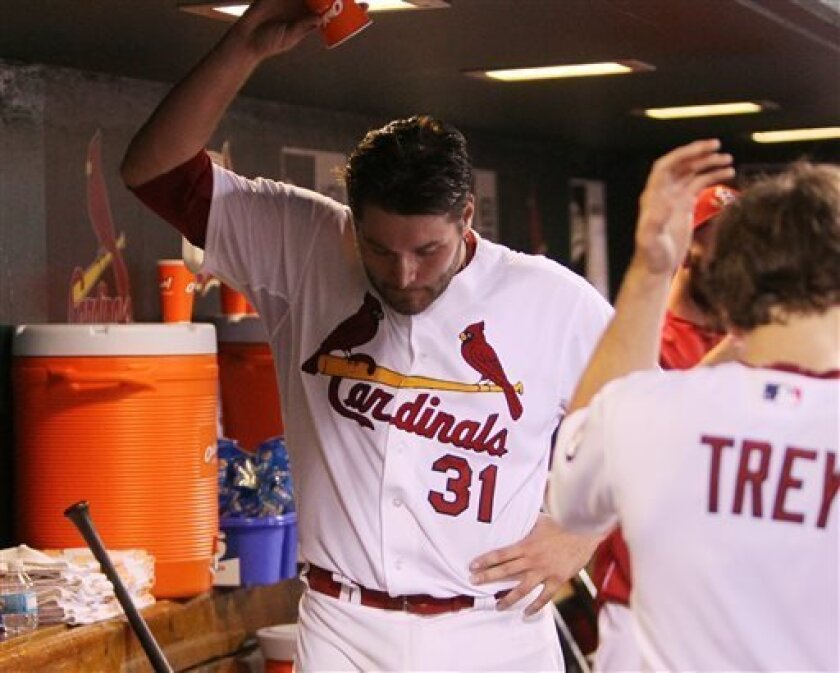 St. Louis Cardinals starting pitcher Lance Lynn slams down a paper cup after allowing a run and being relieved in the seventh inning during a baseball game against the Chicago Cubs on Friday, Aug. 9, 2013, at Busch Stadium in St. Louis. (AP Photo/St. Louis Post-Dispatch, Chris Lee)