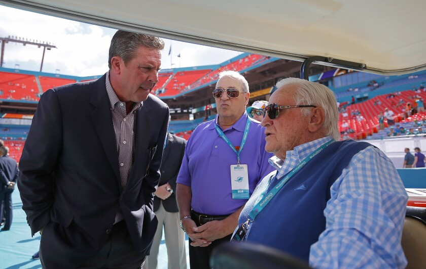 Former Miami Dolphins quarterback Dan Marino, left, speaks with Don Shula.