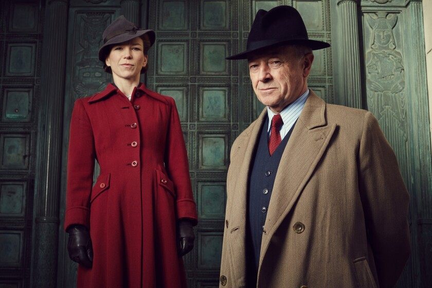 "Michael Kitchen as Christopher Foyle, right, and Honeysuckle Weeks as Samantha Wainwright in ""Foyle's War."""