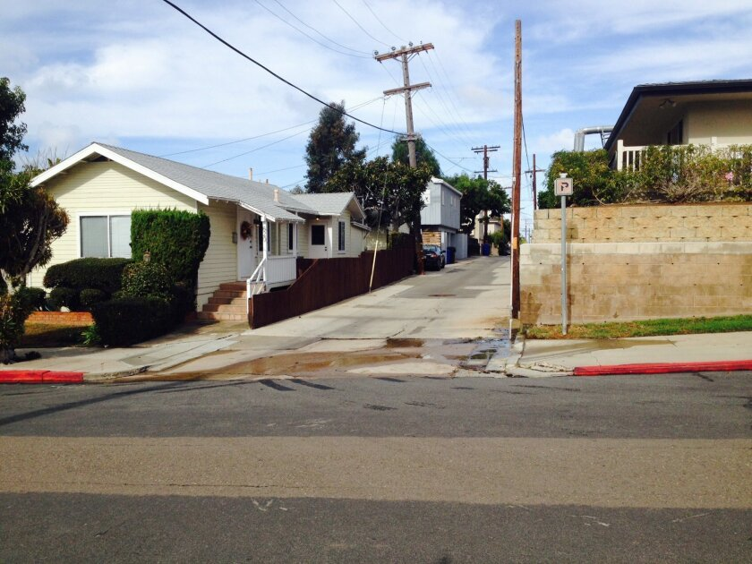 View of a home (left) on Rushville Street off Bishop's Lane that its owner wants to demolish and rebuild as two stories. Across the alley is The Cove at La Jolla, a skilled nursing facility.