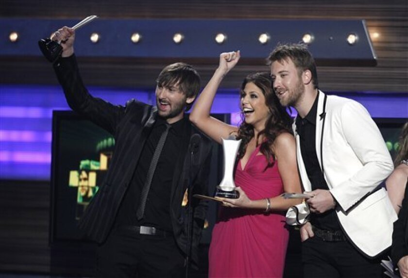 From left,  Dave Haywood, Hillary Scott, and Charles Kelley, of the band Lady Antebellum, accept the song of the year  award at the 45th Annual Academy of Country Music Awards in Las Vegas on Sunday, April 18, 2010.  (AP Photo/Matt Sayles)