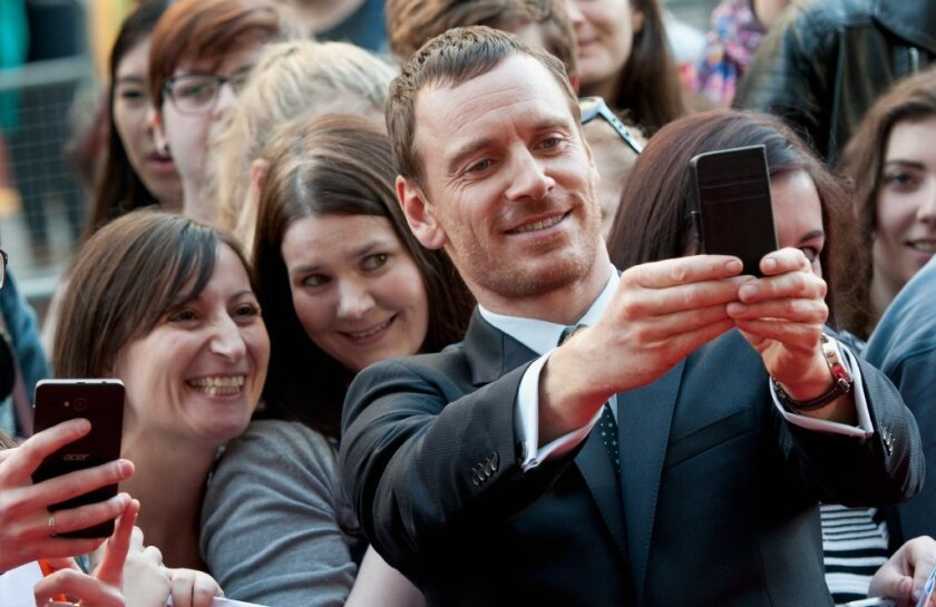 "Given what Michael Fassbender has told us about his ""allergic reaction"" to technology, we're guessing there's only a 50/50 chance this photo turned out."
