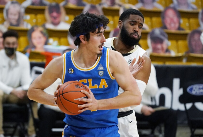 UCLA guard Jaime Jaquez Jr. pulls in a rebound in front of Colorado forward Jeriah Horne.
