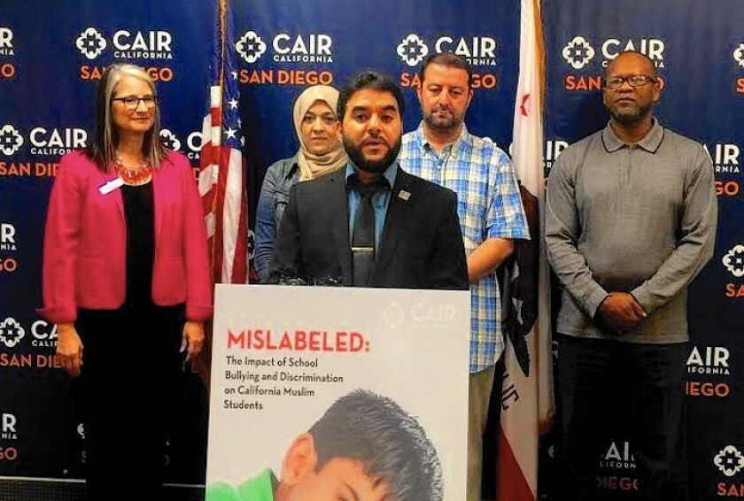 Hanif Mohebi, executive director of the San Diego office of the Council on American-Islamic Relations, speaks at a news conference Friday about the bullying of Muslim students in schools.