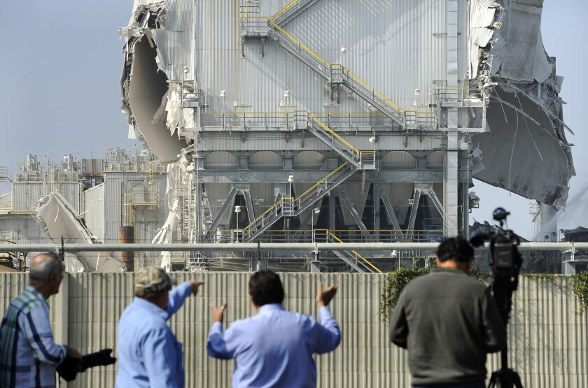 An explosion at the Exxon Mobile refinery in Torrance damaged a pollution control system and forced the plant to reduce operations to 20% of normal production.
