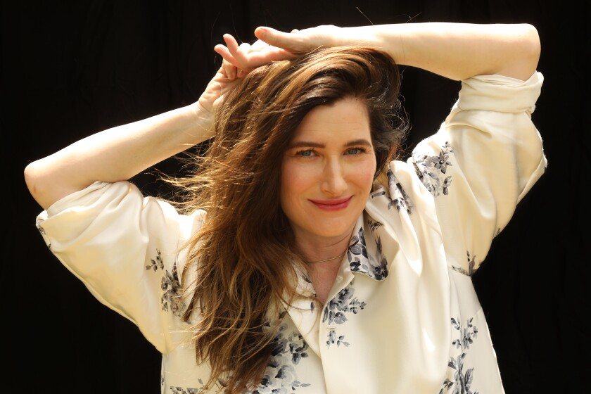 Actor Kathryn Hahn relaxes with her hands on her head