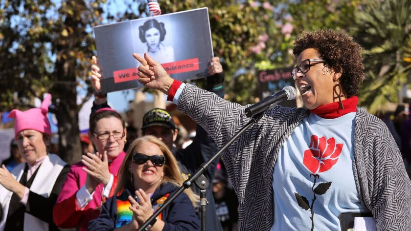 Sharon Elise, Ph.D, Sociology Department Chair at Cal State San Marcos, speaks at the North County Women's March rally at Palomar College prior to the march.
