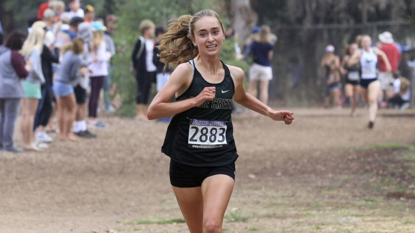 Skyler Wallace, of Sage Creek, finishes first, well ahead of the second place finisher in the girls