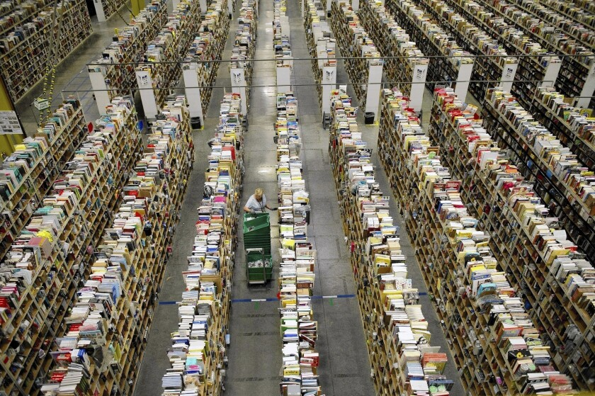 """In the long-run, an employee staying somewhere they don't want to be isn't healthy for the employee or the company,"" Amazon Chief Executive Jeffrey Bezos said. Above, an Amazon employee stows items at the fulfillment center in Phoenix."