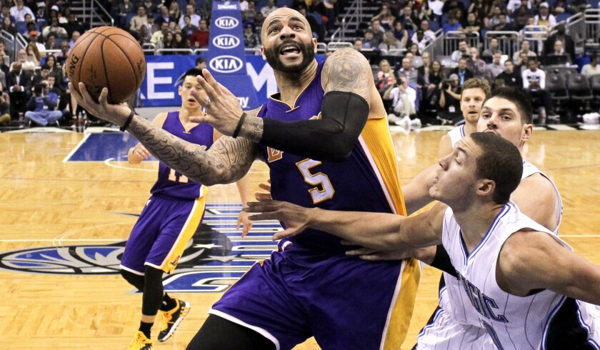 Carlos Boozer (5) and the Lakers missed an opportunity to beat Aaron Gordon and the Magic on Friday, but they'll play 17 opponents with losing records in their final 32 games this season.