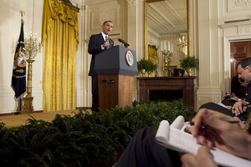 President Obama speaks during a news conference in the East Room of the White House, defending Atty. Gen. Eric H. Holder Jr.