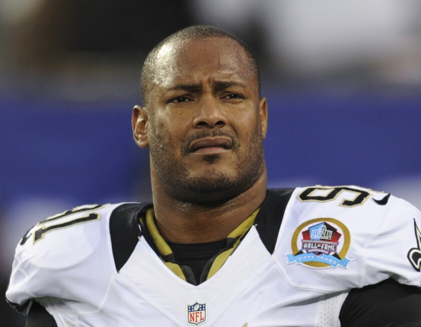 FILE - In this Dec. 9, 2012, file photo, New Orleans Saints defensive end Will Smith appears before an NFL football game against the New York Giants in East Rutherford, N.J. Cardell Hayes, who fatally shot former NFL star Smith following a 2016 traffic collision, has a bond hearing scheduled Thursday, March 4, 2021, seeking freedom after his manslaughter conviction in Smith's death was overturned because his trial jury's vote was not unanimous. (AP Photo/Bill Kostroun, File)